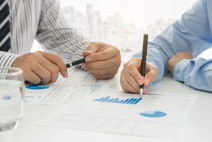 Business adviser are analyzing market data to clients or partners have been informed. Business Analysis Concept.